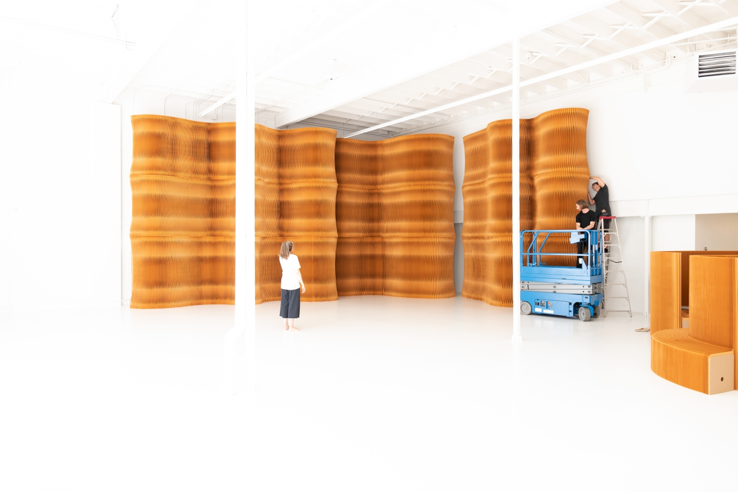 paper architecture built of acoustic partitions that can be made into any shape. These paper folding walls make for sculptural backdrops as well as practical privacy screens.