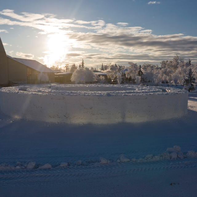 The alaskan sun sets over northern sky circle, a snow maze designed by Stephanie Forsythe + Todd MacAllen for FREEZE