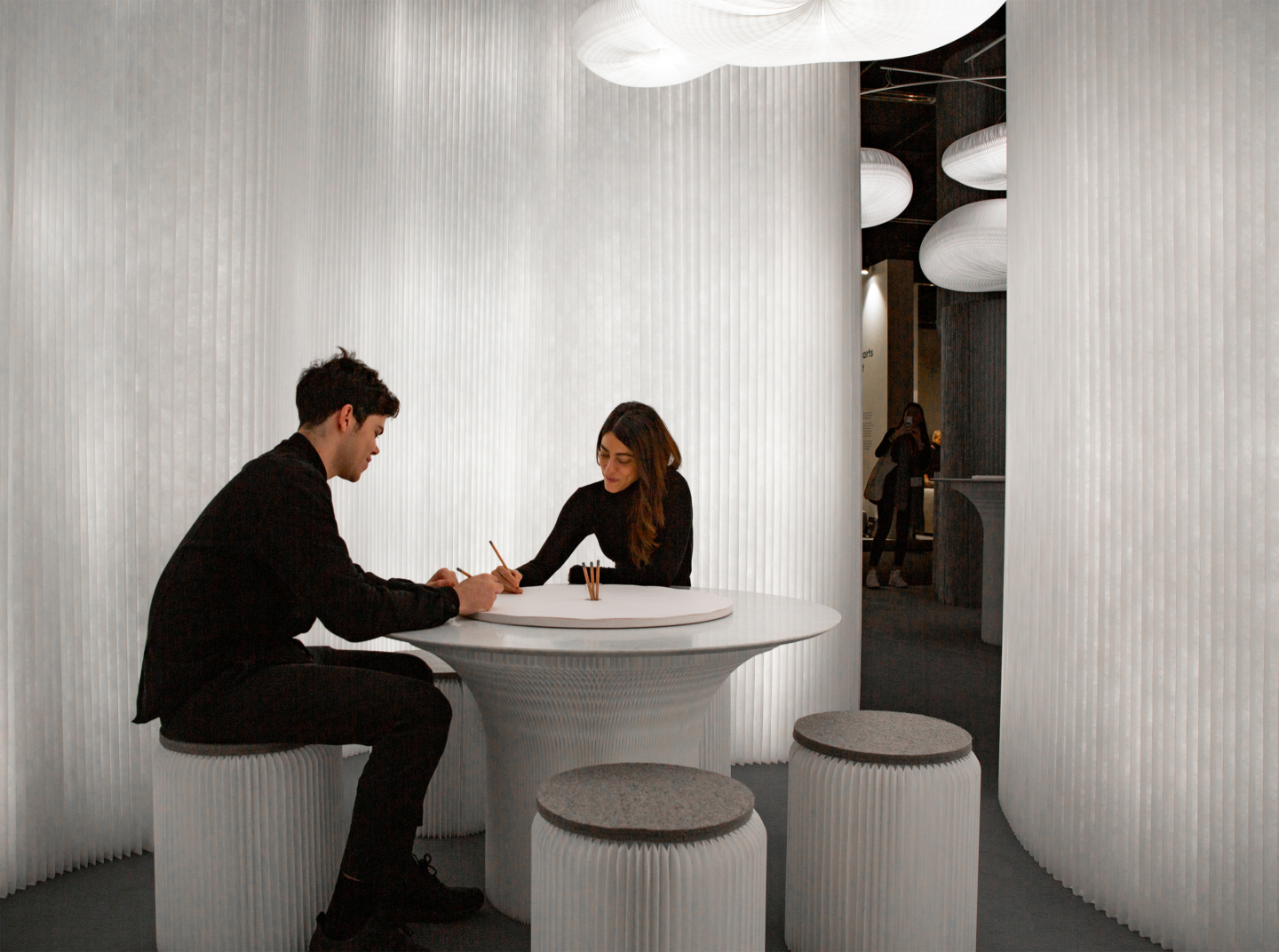 aluminum room divider wall back lit with led lights, cloud pendant light led, stools and cantilever table by molo